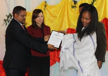 Tirhas Accepts Award