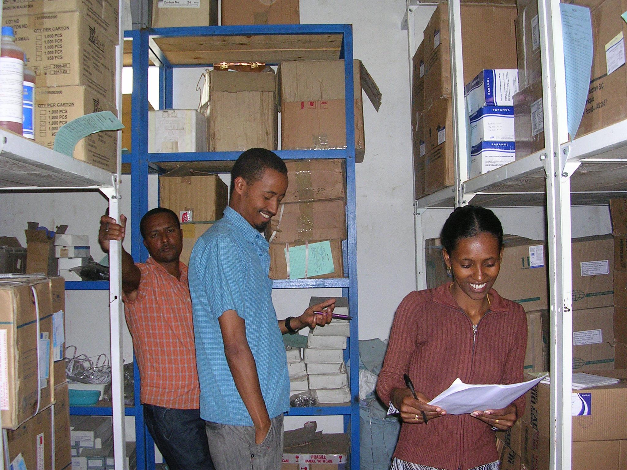 Health center staff work to improve storage practices in their storeroom